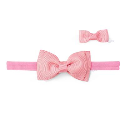 faixa-de-cabelo-com-laco-rosa-chiclete